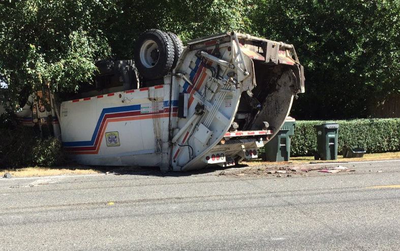 LeMay garbage truck rolls over in NE Olympia